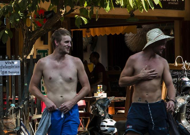 Topless dudes on Pub Street.