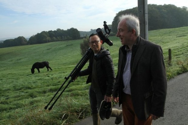 Moviemaker Patrick Shen (left), with documentary subject Dirk Sturtewagen, walking the hills of Belgium in Shen's film In Pursuit of Silence. Courtesy of Transcendental Media