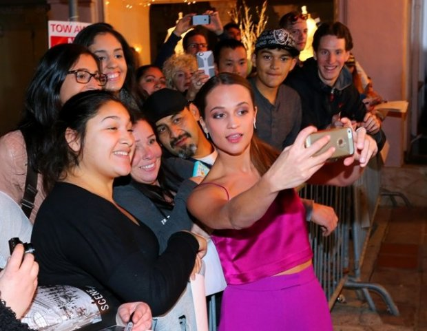 Alicia Vikander takes pictures with fans at the 2016 Santa Barbara International Film Festival