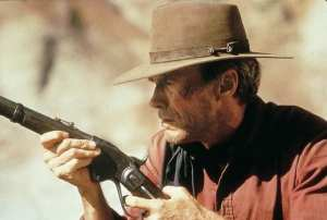 """Unforgiven (1992)<center><img class=""""alignnone size-full wp-image-304"""" src=""""https://www.moviereviews.us/wp-content/uploads/2018/09/IMG_2353-2-1.jpg"""" alt="""""""" width=""""107"""" height=""""24"""" /></center>"""