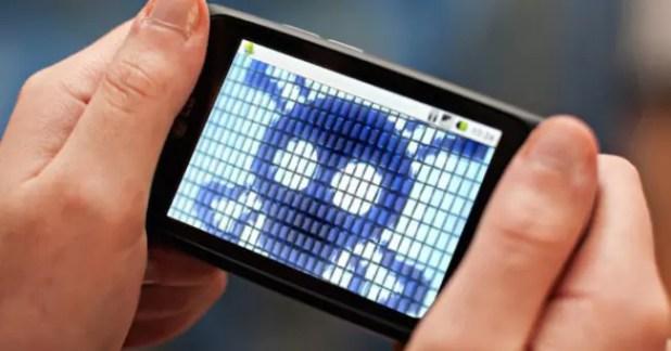 smartphone con símbolo de calavera