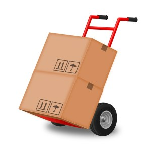 Moving boxes on a hand truck using moving services NJ