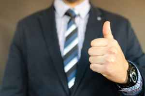 A thumbs-up gesture for the quality of senior movers.