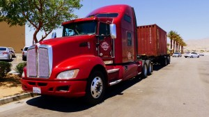 Red closed vehicle carrier truck from car shipping companies NJ.