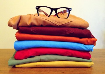 A pile of clothes with glasses on top