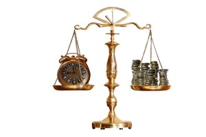 Scale with clock on one side and money on the other.