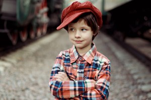 A little boy wearing a cap.