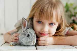 a young girl with a rabbit