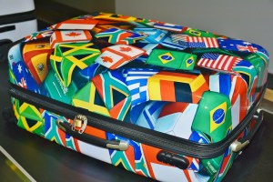 A suitcase with flags.