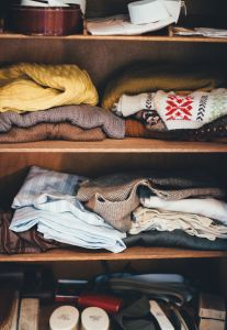 sweaters in a storage unit