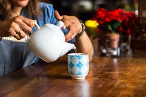 Person pouring tea.