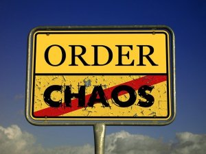 Order and chaos written on a street sign