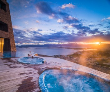 Outdoor swimming pool and jacuzzi at sunset