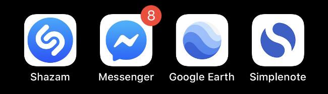 Quatre icônes d'application iOS bleues.