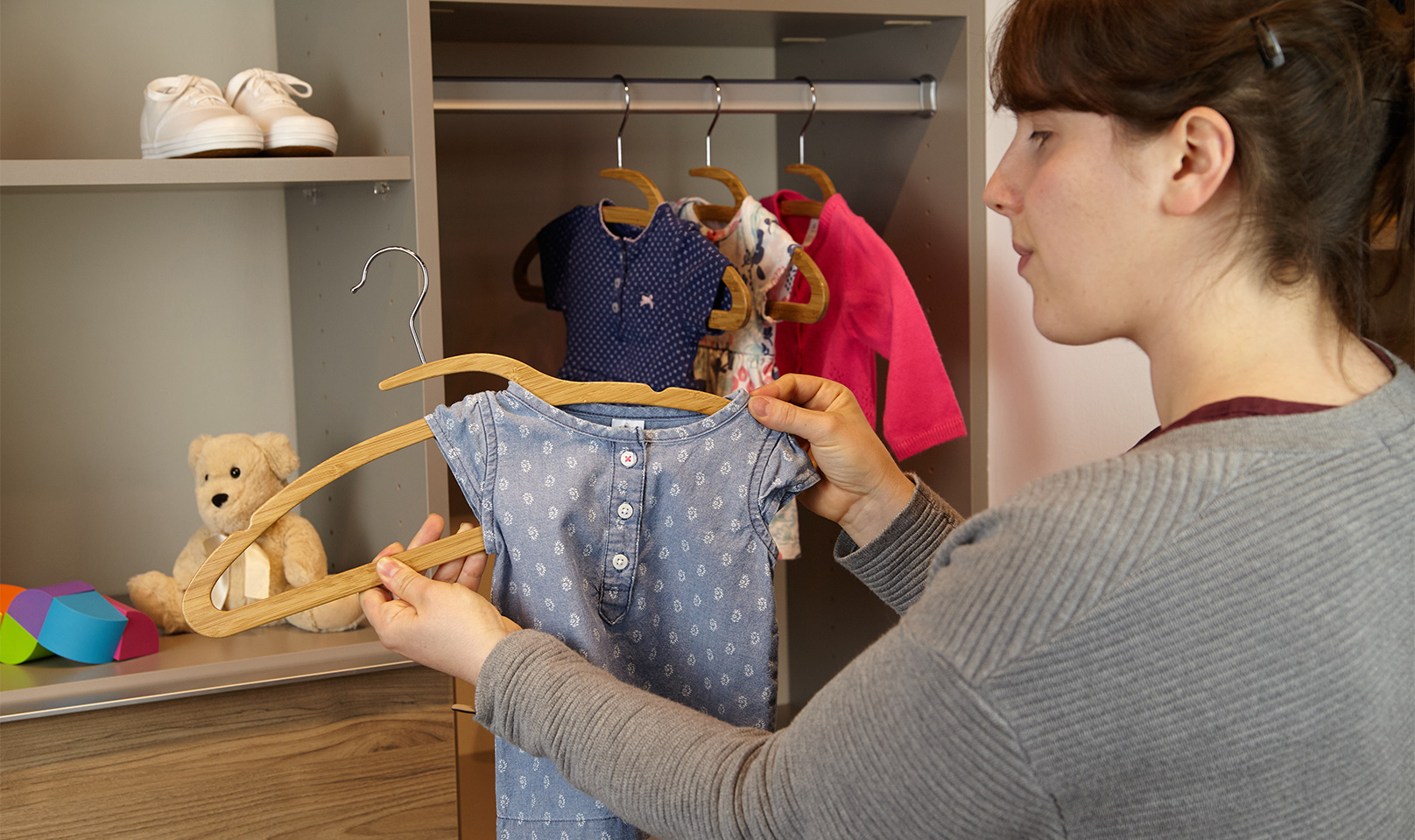 Bamboo Mozu Hanger being used with baby clothing