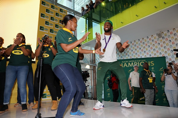 Springboks captain, Siya Kolisi, in joyous mood with an MTN staffer at the Trophy Tour at MTN Headquarters in Fairland on Thursday.