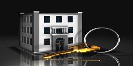 Large Key With Commercial Building Graphic