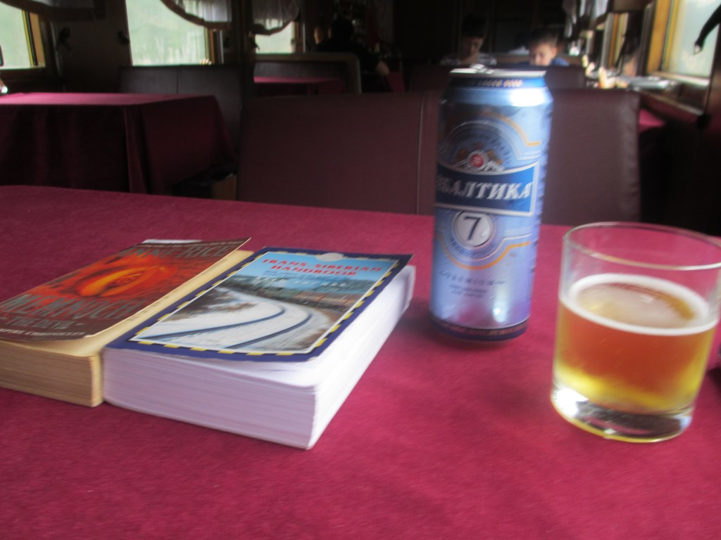 My books and cold beer in the restaurant car, aboard the Trans-Siberian