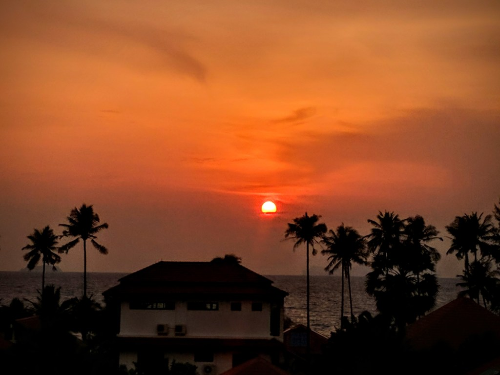 That Orange Room view - with sunset at Cozy Guesthouse