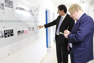 Prof Umberto explaining The Unit's Chronology to Rt Hon Boris Johnson MP, the United Kingdom (UK) Secretary of State for Foreign and Commonwealth Affairs