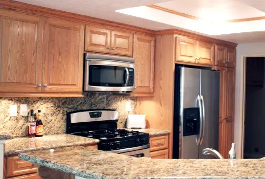 oak cabinets kitchen tall garbage can red in southern california have you grown tired of your s look if needs a visual boost consider adding will make the