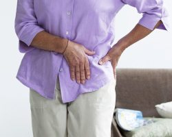 Person suffering hip pain