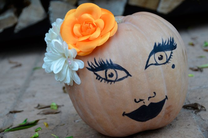 Decorate Pumpkins By Using A Paint Marker To Write