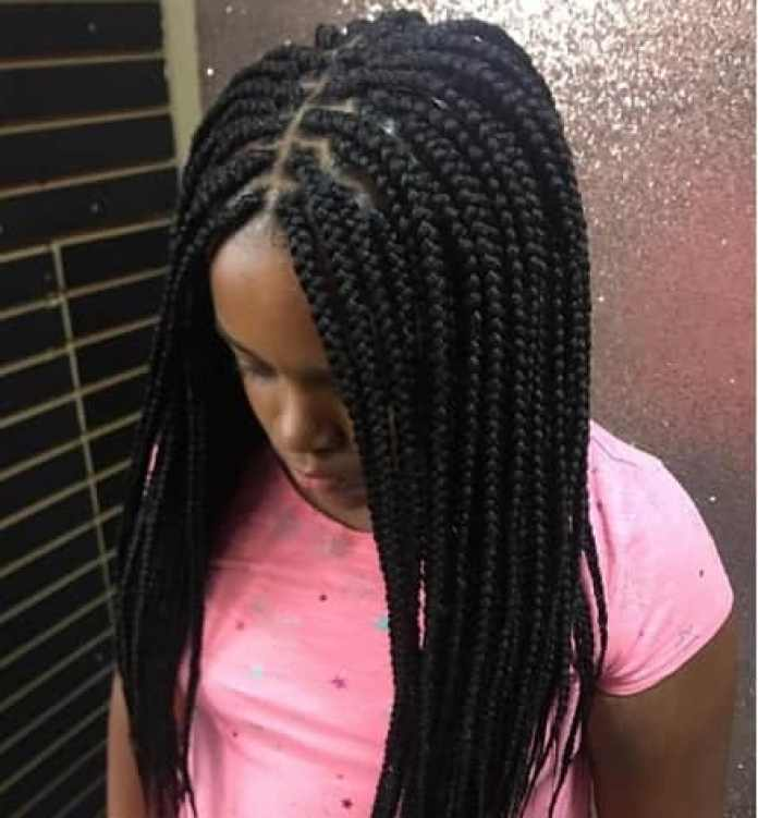 Center Parted Thick And Long Braids