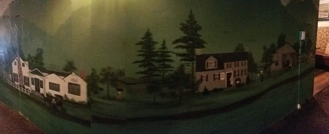 A mural painting of Franklin Corners inside the Grain House restaurant including the Grain House on the left. Credit:Brooks Betz