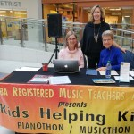 Teachers at the donation table at Musicthon 2018