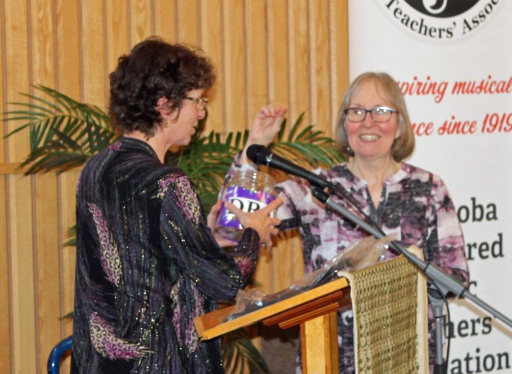 Leanne Hiebert and Evangeline Keeley drawing the winner