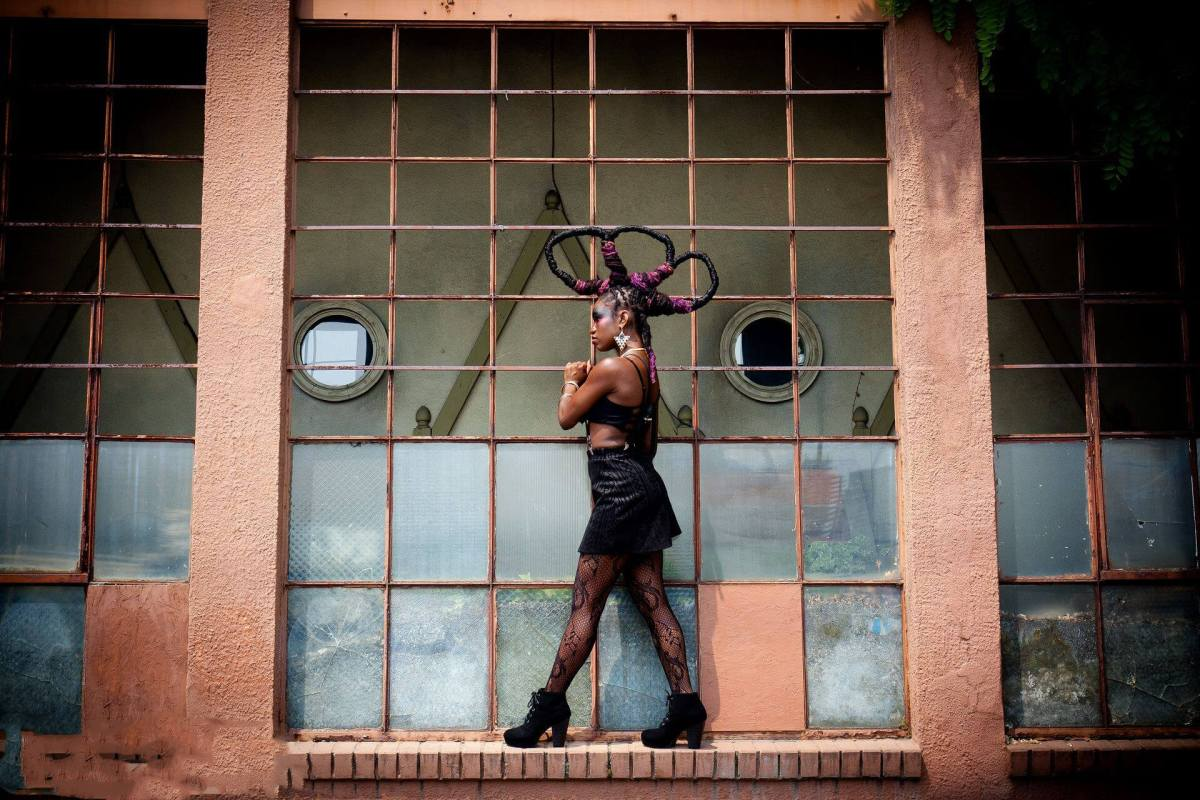 woman against window with dreads styled into loops