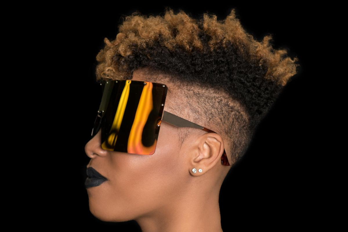 Woman with mohawk haircut with highlights