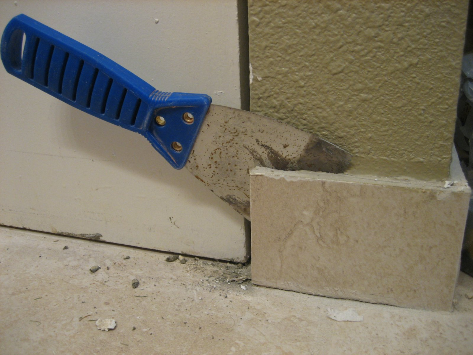 removing tiles using putty knife