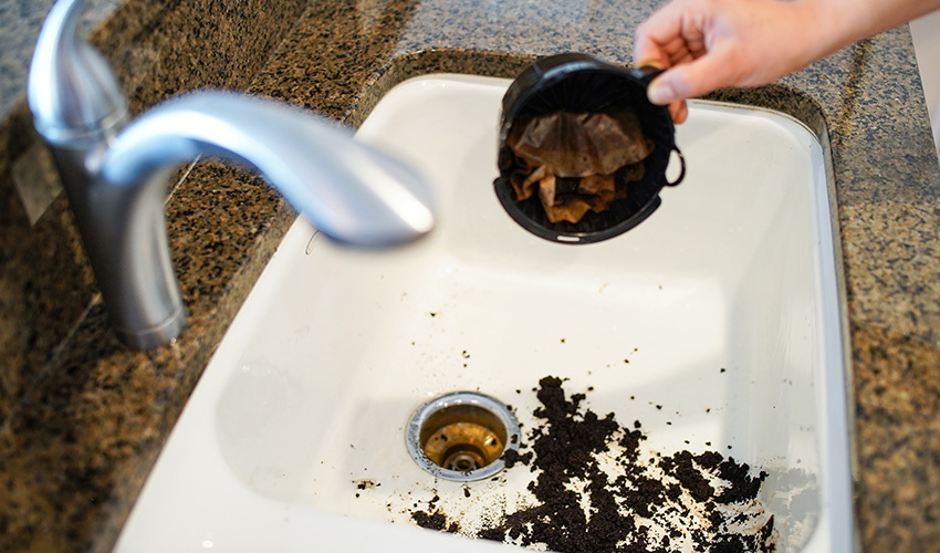 you put coffee grounds down the sink