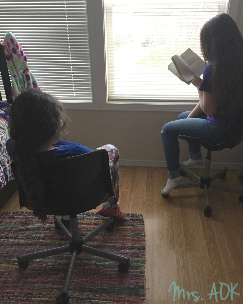 Big Sis reading to Little Sis