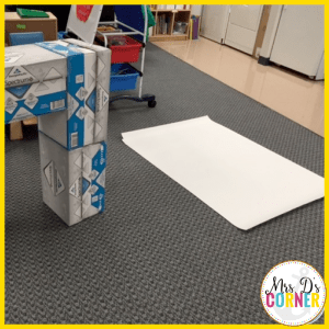 Use large white butcher paper to wrap the boxes.