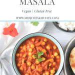 chana masala chickpea curry in bowl with rice and naan.