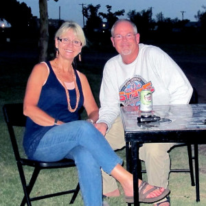 Mr. & Mrs. Padilly sitting at her Heirloom Glamping Table