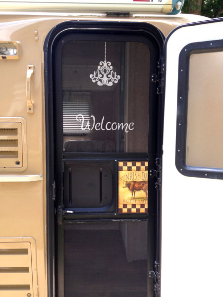 Mrs. Padilly's Completed Stenciling of Screen Door with Chandelier and Welcome Sign