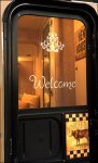 Welcome Stencil on Screen Door Casita Travel Trailer