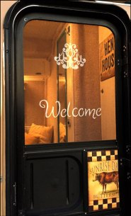 Stenciling Welcome on Screen Door Casita Travel Trailer