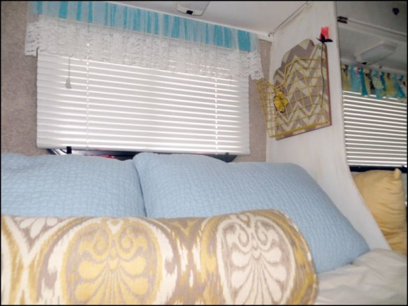 View of Magazine Rack added to Interior wall by bedding of a Casita Travel Trailer.