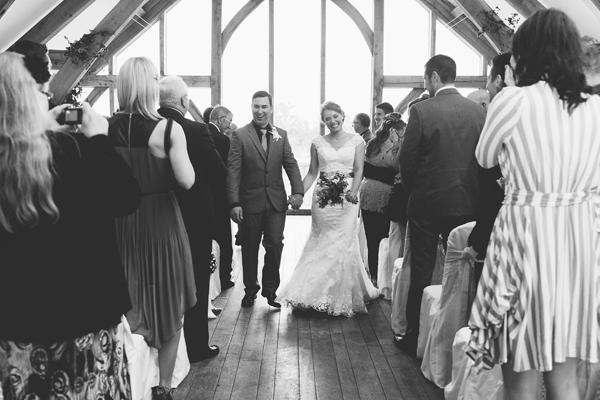 key reflections photography, bride and groom going back up aisle