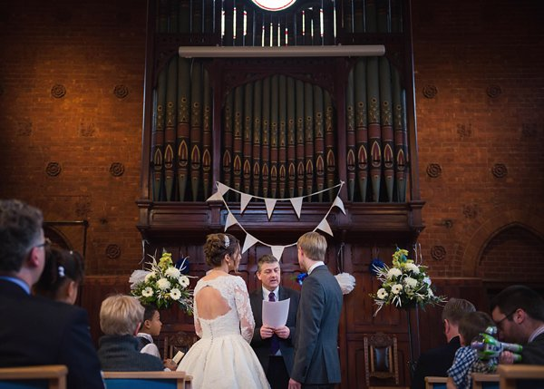 winter wedding, church wedding, julie anne images, anglo dutch wedding , church hall reception, dutch decor, bride, groom and minister at altar, wedding ceremony