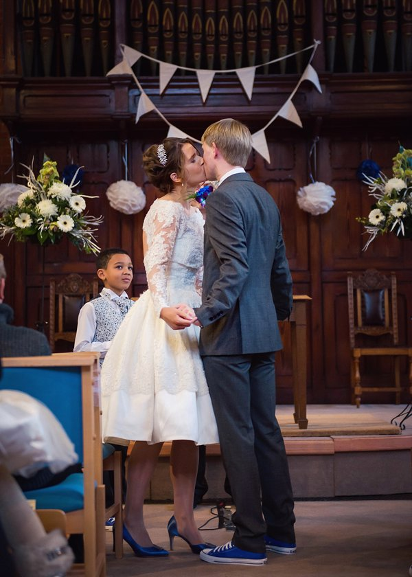 winter wedding, church wedding, julie anne images, anglo dutch wedding , church hall reception, dutch decor, bride and groom at altar, wedding ceremony, first kiss