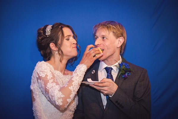 winter wedding, church wedding, julie anne images, anglo dutch wedding , church hall reception, dutch decor, bride and groom eating cake