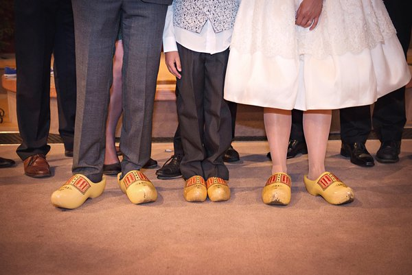 winter wedding, church wedding, julie anne images, anglo dutch wedding , church hall reception, dutch decor, wedding clogs, clogs, clog group shot