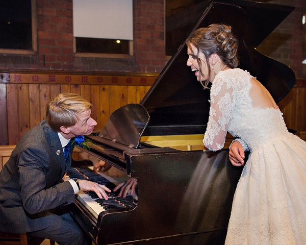 winter wedding, church wedding, julie anne images, anglo dutch wedding , church hall reception, dutch decor, groom playing piano to bride