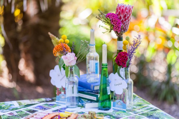 Chris Cowley Photography, DIY Wine bottle candles, fresh flowers in bottles, DIY tablecover, eco friendly shoot, ethical wedding, recycled wedding